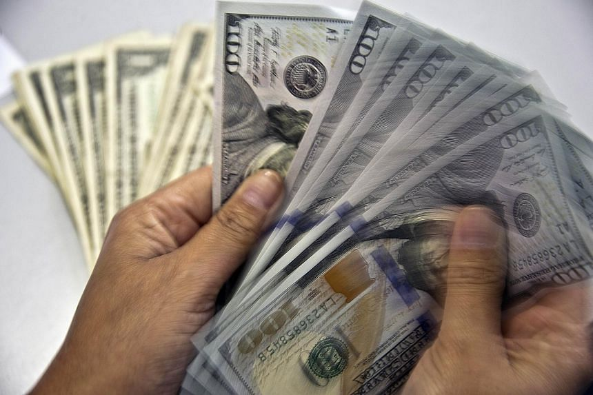 The US dollar fell against the euro and other currencies Wednesday on speculation that the US Federal Reserve will delay hiking interest rates following China's devaluation of the yuan.