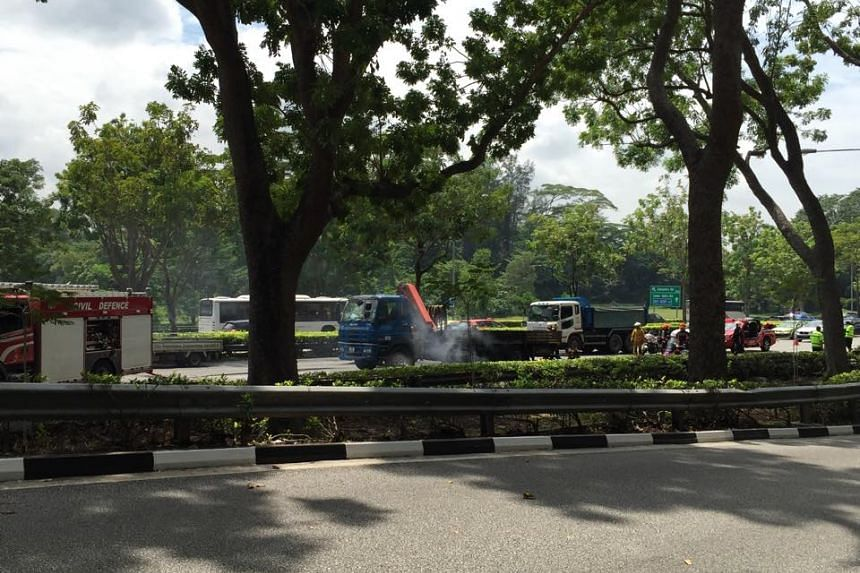 Smoke billowing from the lorry after SCDF extinguished the fire.