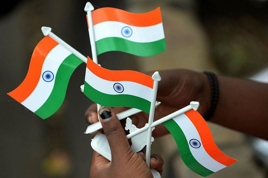 An Indian girl selling miniature Indian tricolour flags in Mumbai.