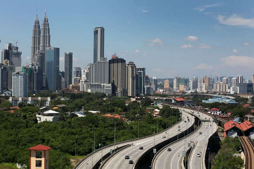 Malaysia's economy grew 4.9 per cent in the second quarter from a year earlier, slightly above expectations.