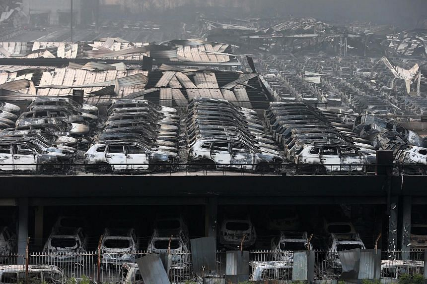 Damaged buildings and cars seen after a huge explosion rocked the port city of Tianjin, China, on Aug 13, 2015.