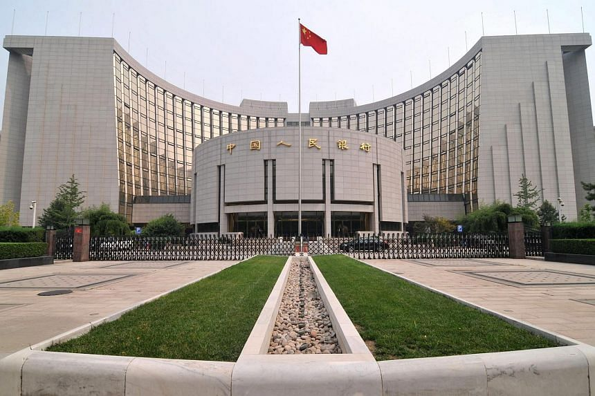 """The People's Bank of China said that the country's strong economic environment, sustained trade surplus, sound fiscal position and deep foreign exchange reserves provide """"strong support"""" to the exchange rate."""