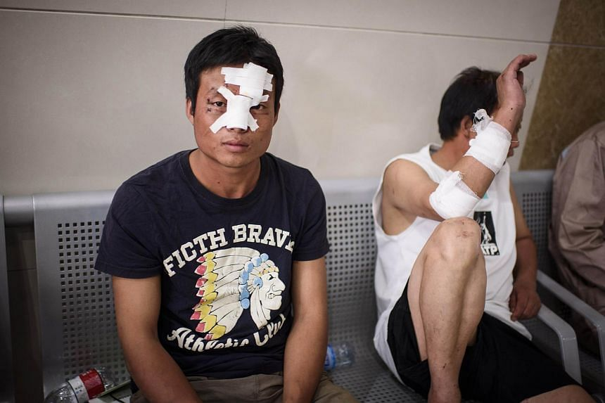 Injured migrant workers wait for further treatment at Gangkou hospital in Tianjin following a series of explosions at a warehouse in the northern Chinese city on Aug 13, 2015.  PHOTO: