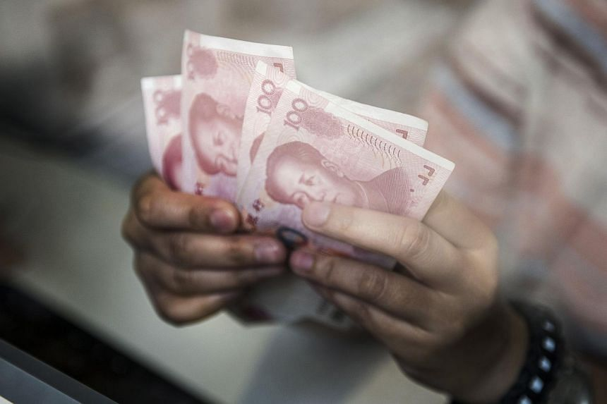 China's central bank has stepped up intervention in yuan trading, ordering state banks to buy yuan at designated rates on behalf of the monetary authorities.
