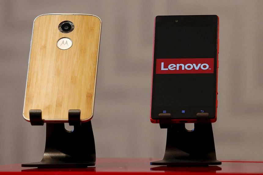 Lenovo and Motorola smartphones are displayed during a news conference in Hong Kong, China.