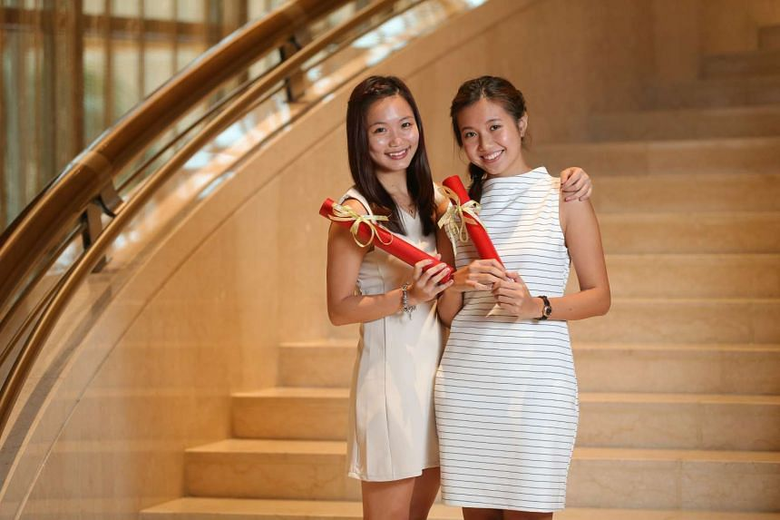 Angelia (left) and Alissa Ong will soon share careers in the maritime industry.