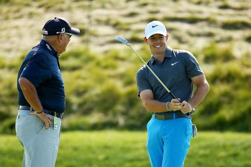 Rory McIlroy(right) of Northern Ireland chats with Butch Harmon during a practice round prior to the 2015 PGA Championship at Whistling Straits on Aug 12, 2015 in Sheboygan, Wisconsin.