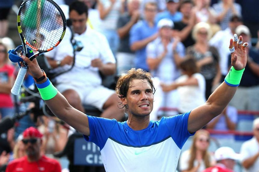 Rafael Nadal waves to the crowd after winning against Sergiy Stakhovsky of Ukraine (not pictured) during the Rogers Cup tennis tournament at Uniprix Stadium.