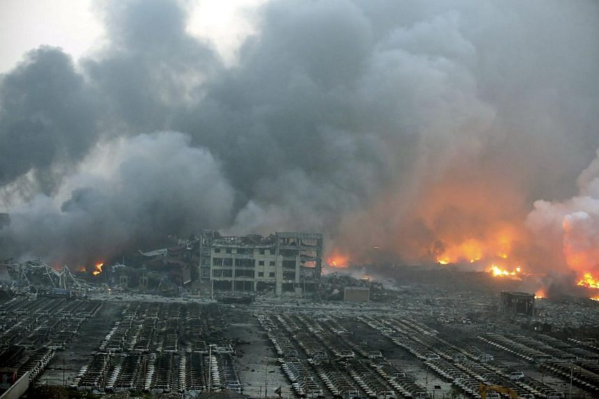 General view of the destruction after explosions in the port area of Tianjin, northern China, Aug 13, 2015.
