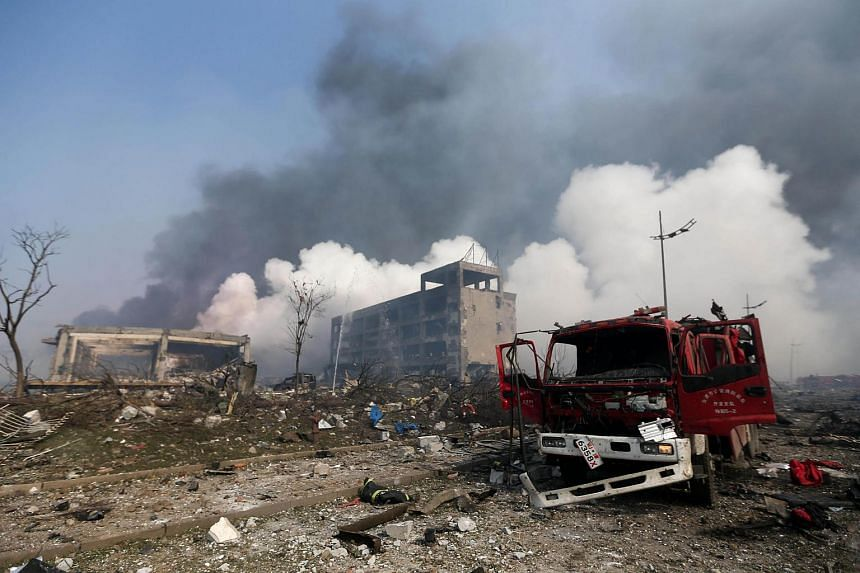 A damaged fire truck is seen at the site of the massive explosions in Tianjin on Aug 13, 2015.
