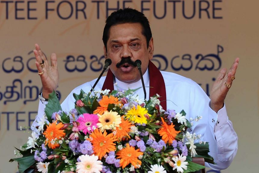 Former Sri Lankan president and parliamentary candidate Mahinda Rajapakse speaks during the launch of the election manifesto in Colombo on July 28, 2015. PHOTO: AFP