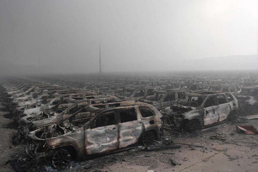 Rows of burnt out cars after a series of explosions at a chemical warehouse hit the city of Tianjin on Aug 12, 2015.