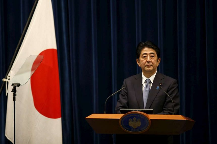 Japan's Prime Minister Shinzo Abe delivering a statement marking the 70th anniversary of World War Two's end, at his official residence in Tokyo.
