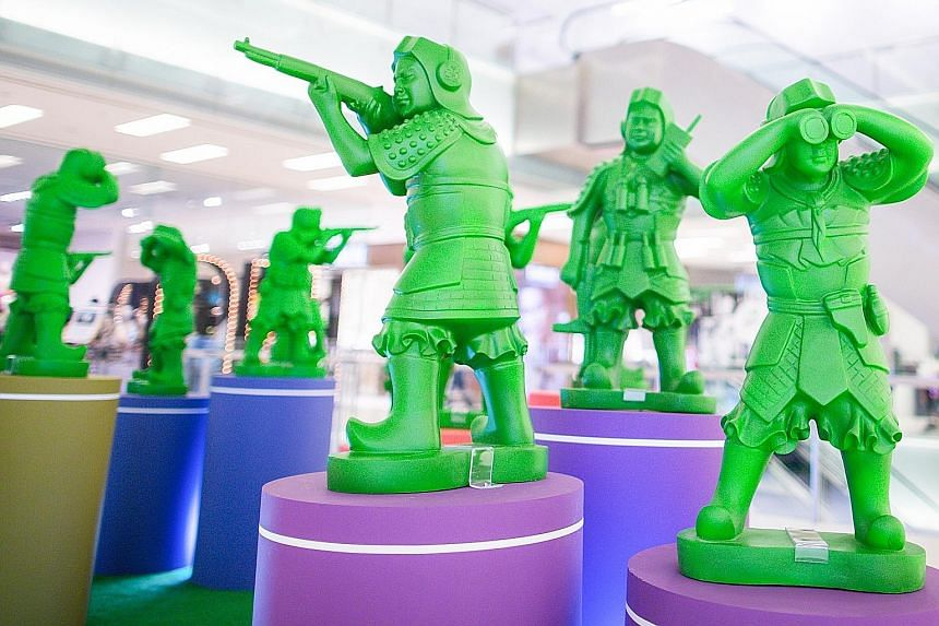 The artist draws on his childhood memory to create this tongue-in-cheek installation of miniature green toy soldiers (above), popular in the 1960s, transformed into mighty contemporary warrior sculptures in a mall.