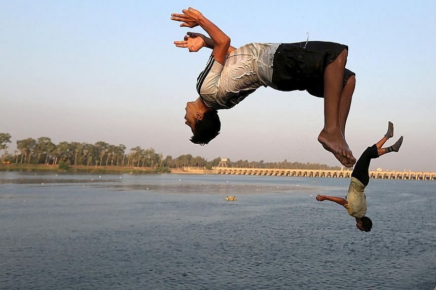 These boys were literally jumping for joy at the chance to cool themselves down by leaping into the river Nile during hot weather on the outskirts of Cairo, Egypt, on Wednesday. A heatwave killed at least 61 people across Egypt from Sunday to Tuesday