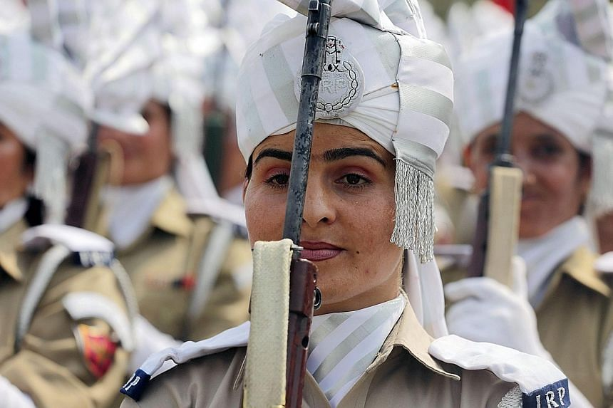 Female members of the Indian police force taking part in an Independence Day parade rehearsal yesterday in Indian Kashmir, where a grenade exploded outside a mosque and injured 10 worshippers.
