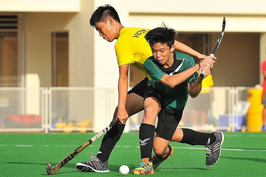 Far right: Victoria School's Issac Ho (in yellow) challenging for the ball with Raffles Institution captain Ethan Tan. RI won the C boys final 1-0. Right: Teck Whye Secondary School celebrating their C Division triumph over Crescent Girls on penalty