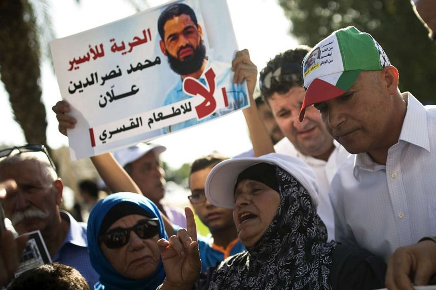 Allan's mother, Maazouzeh Allan (centre), takes part in a protest against force-feeding her son on Aug 9, 2015.