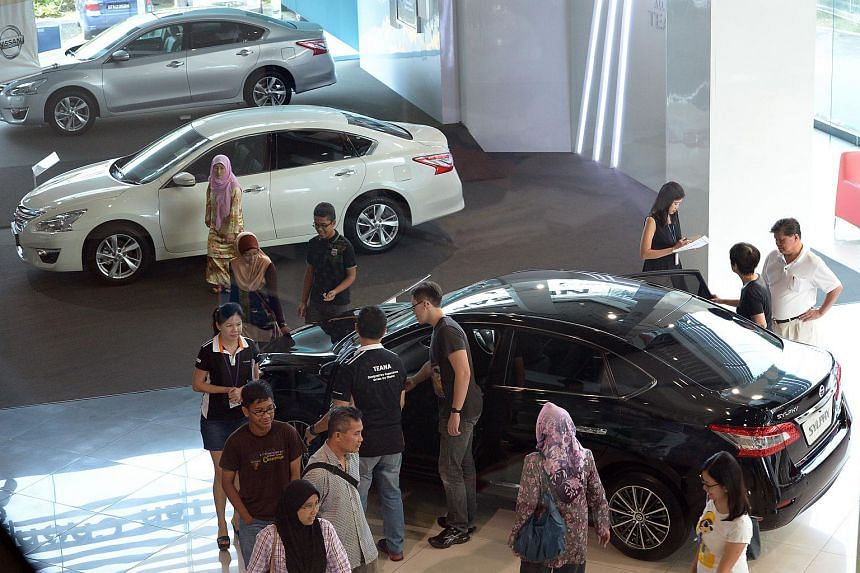 Potential buyers at the Nissan showroom.