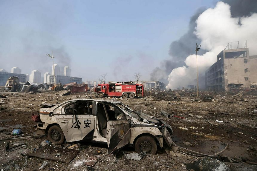 A damaged police car at the site of the massive explosions in Tianjin on Aug 13.