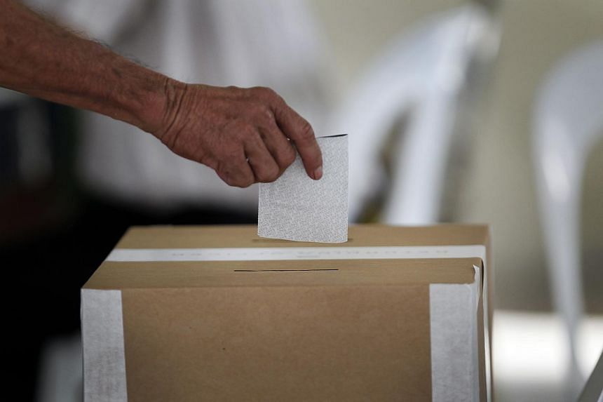 A voter casting a ballot during the 2011 General Election.