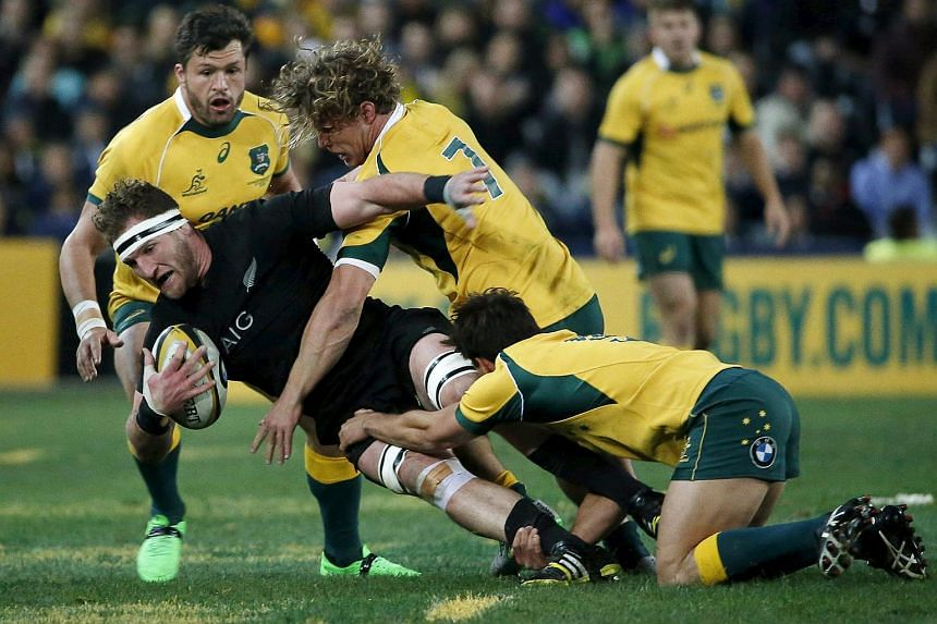New Zealand All Blacks' Kieran Read (left) is tackled by Australian Wallabies' Michael Hooper (7) during their Bledisloe Cup rugby match in Sydney on Aug 8.