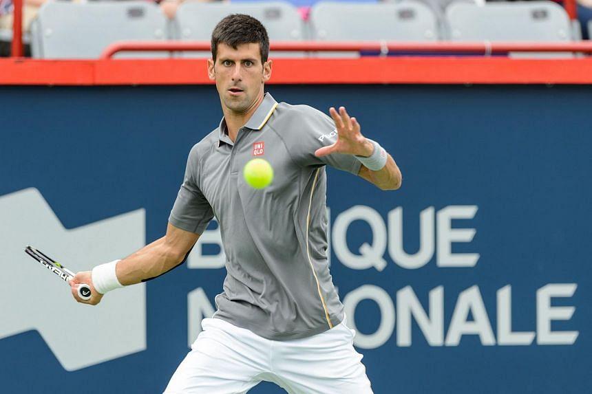 Novak Djokovic hitting a return against Jack Sock during the Rogers Cup tennis tournament on Aug 13, 2015.