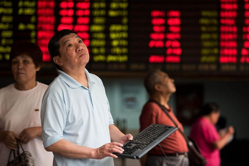 Investors monitoring stock market movements at a brokerage in Shanghai on Aug 13.