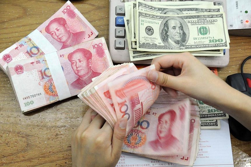 China's central bank on Friday strengthened the yuan against the US dollar by 0.05 per cent, ending three days of falls.