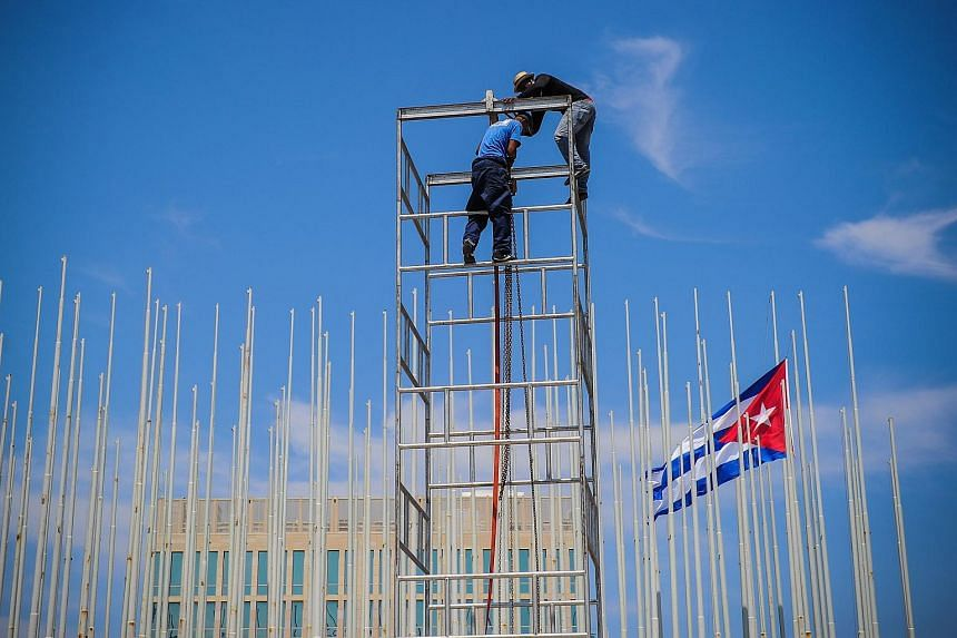 Workers setting up a dais at the US embassy in Havana during preparations for its inauguration, on Aug 12.