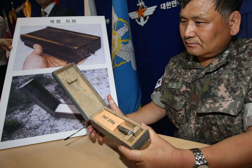A South Korean officer gives an account on wooden-box mines during a press conference in Seoul, South Korea on Aug 10, 2015.