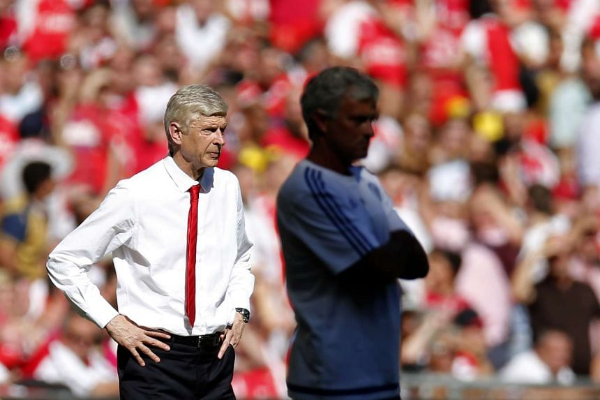 Arsenal manager Arsene Wenger (left) and Chelsea manager Jose Mourinho (right).