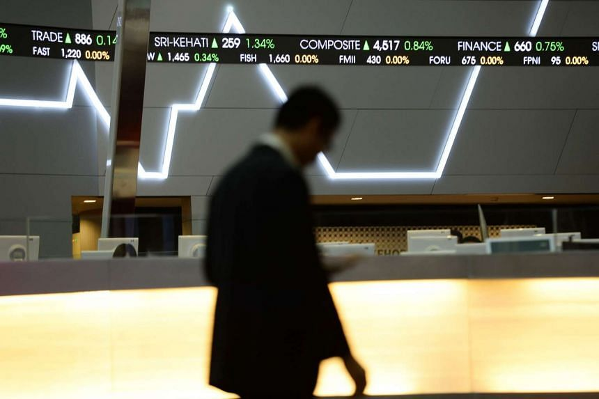 Tickers display stock prices inside the Indonesia Stock Exchange (IDX) in Jakarta, Indonesia, on Aug 13, 2015.
