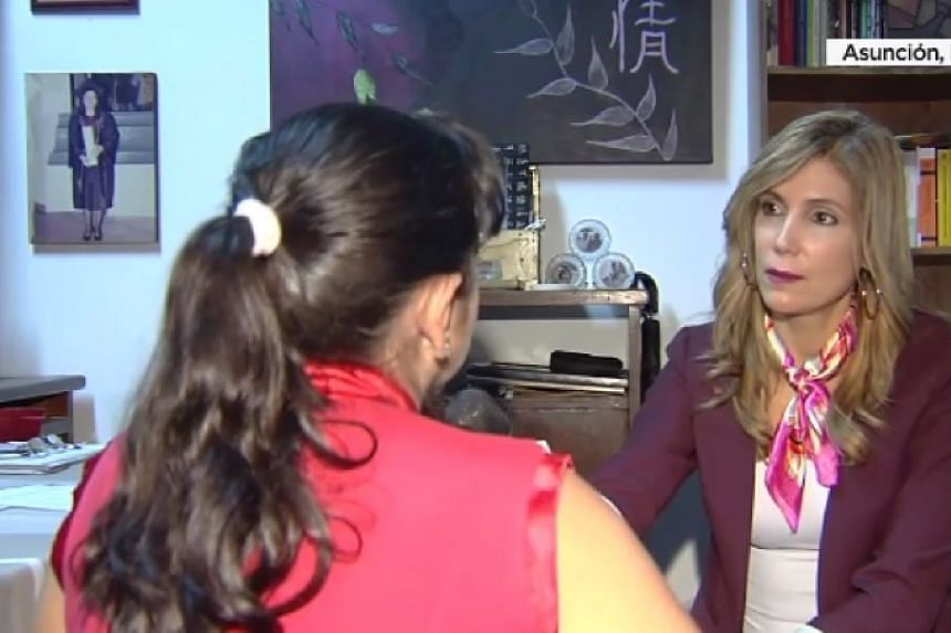 A screenshot of the girl's mother (left) being interviewed by a US TV reporter.