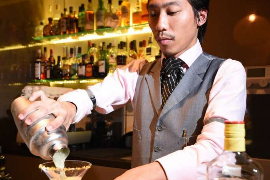 Bartender Anthony Zhong offers up new concoctions such as Osmanthus Gimlet (above).