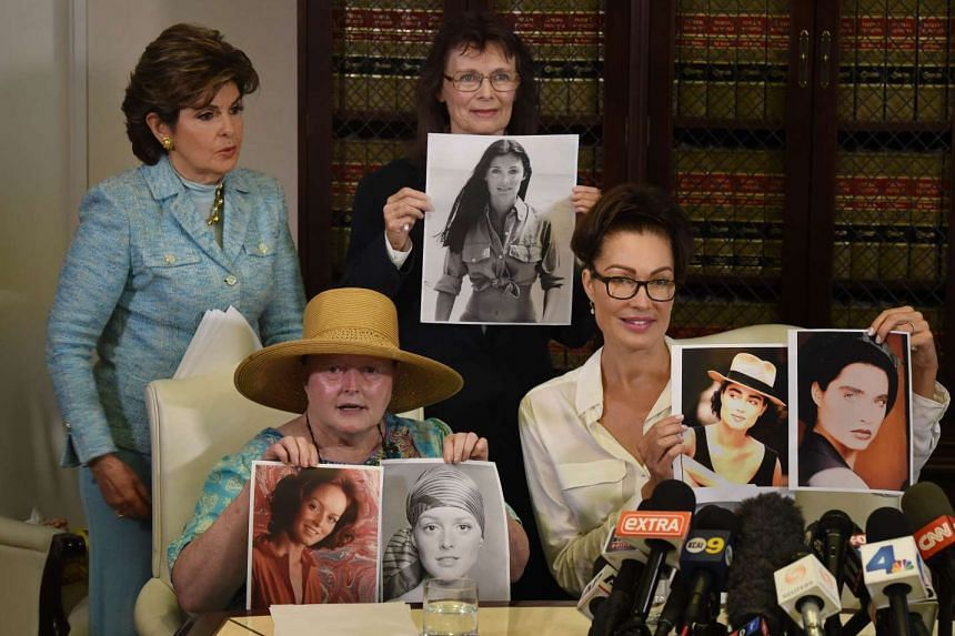 Alleged sexual assault victims of comedian Bill Cosby, (from left) Ms Colleen Hughes and former actresses Linda Ridgeway Whitedeer and Eden Tirl, hold up younger photos of themelves as lawyer Gloria Allred stands with them.