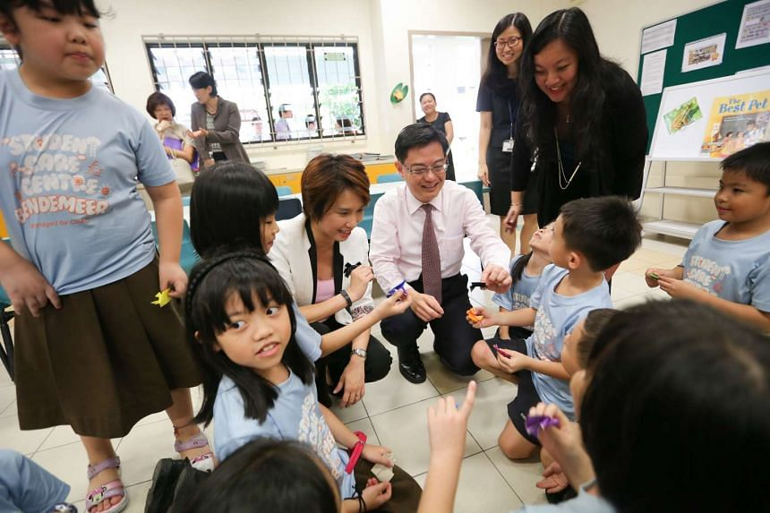Education Minister Heng Swee Keat and Ms Low Yen Ling, Parliamentary Secretary for the Ministry of Social and Family Development, observing pupils in the school-based student care centre at Bendemeer Primary School. A joint venture to be set up by th