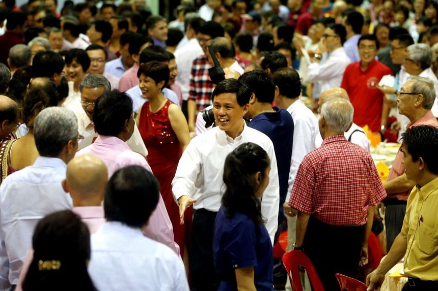 Mr Chan Chun Sing (centre) and Ms Indranee Rajah (in red) mingling with Tanjong Pagar GRC residents at the dinner last night.