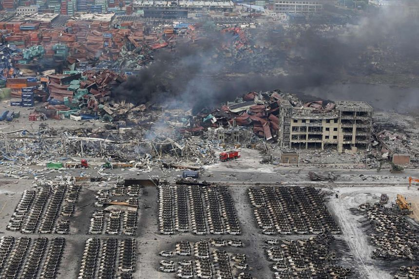 Smoke rises at the site of an explosion in Tianjin on Aug 14, 2015.