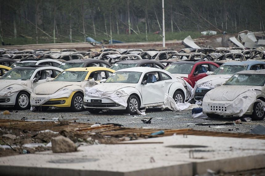 Rows of damaged Volkswagen cars after a series of explosions at a chemical warehouse hit the city of Tianjin on Aug 14.