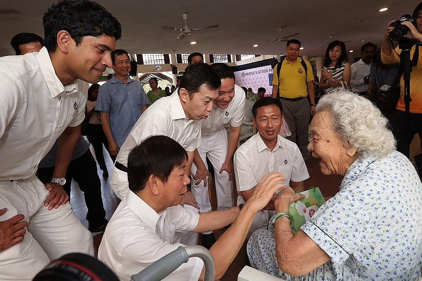 PAP candidates for Sembawang GRC (from left) Vikram Nair, Khaw Boon Wan, Lim Wee Kiak, Amrin Amin and Ong Ye Kung chatting with a resident at Sembawang's Swami Home for the elderly needy after Mr Khaw unveiled the party's new slate for the GRC. Mr Am