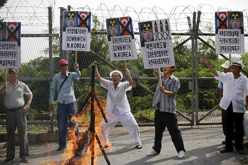 Activists chanting slogans during an anti-North Korea rally near the demilitarised zone separating the two Koreas in Paju, South Korea, on Tuesday.