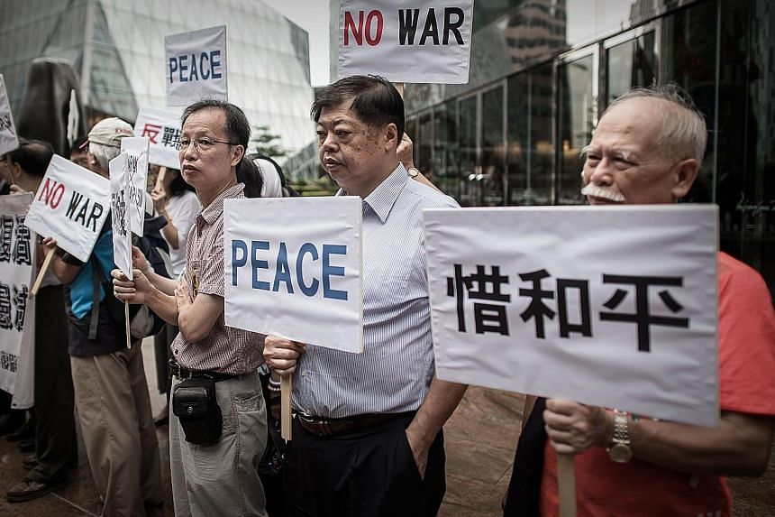 A rally outside the Japanese consulate in Hong Kong yesterday, the day Japanese Premier Shinzo Abe made a statement ahead of the 70th anniversary of the end of World War II.