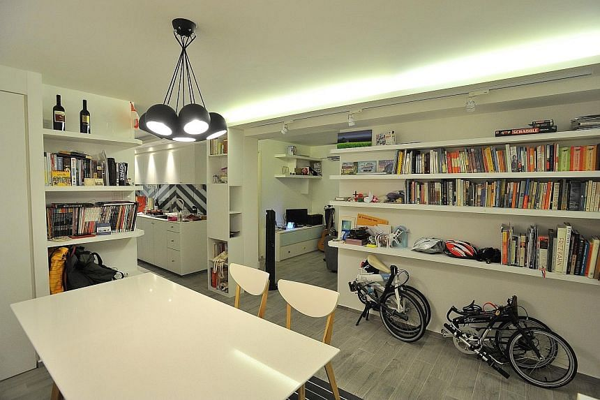 An open space beyond the kitchen is where the home owner takes her breakfast daily. Home owner Faith Goh (left) and interior designer Vincent Goi (far left), who was behind the look of her home. (Above) Ms Goh's bedroom. (From far left) Different sea