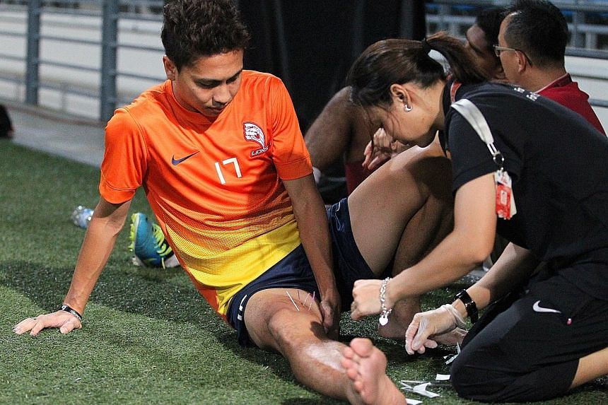 LionsXII physiotherapist Nurhafizah Sujad performing acupuncture on then skipper Shahril Ishak during training back in 2013.