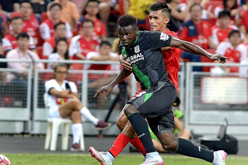 Shakir Hamzah challenging Stoke forward Mame Biram Diouf during their Barclays Asia Trophy match last month. The Singapore defender has had a spate of disciplinary issues this season, but has since knuckled down and rediscovered his best form for the