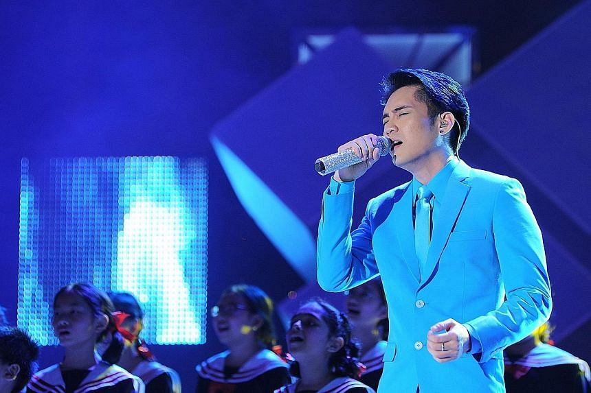 Desmond Ng wins $20,000 cash singing Jay Chou's hit Fearless and the ballad Father by the Chopstick Brothers.