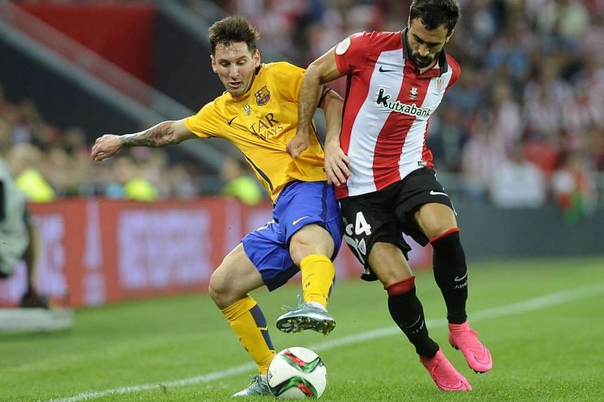 Barcelona's Argentinian forward Lionel Messi (left) vies with Athletic Bilbao's defender Mikel Balenziaga.