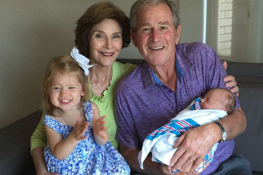 Former US president George W. Bush with former first lady Laura Bush and their two grandaughters.