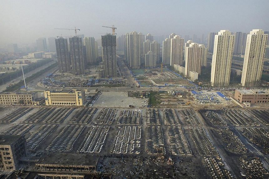 An aerial picture shows damaged cars at the site of Wednesday night's explosions in Tianjin, China, on Aug 15, 2015.